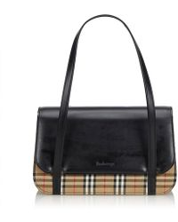 a48104c5438a Burberry - Pre-owned Vintage Black Leather Handbags - Lyst