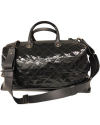 Chanel - Black Patent Leather Travel Bag - Lyst