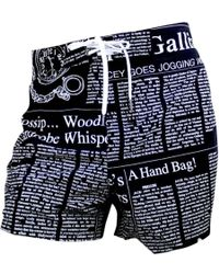 916048b43e John Galliano Newspaper Print Fitted Swim Trunks in Black for Men - Lyst