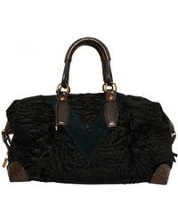 Louis Vuitton - Astrakhan Travel Bag - Lyst