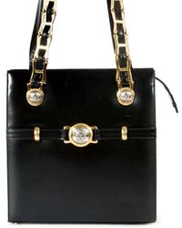 773fab1b8499 Lyst - Versace Pre-owned Black Leather Handbags in Black