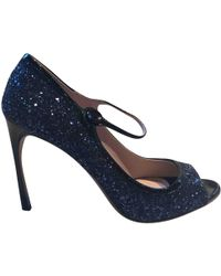 6222546d064 Miu Miu Glitter Heel Tstrap Sandal in Natural - Lyst
