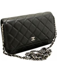cb14bf93a1cb Lyst - Chanel Pre-owned Wallet On Chain Black Leather Clutch Bag in ...