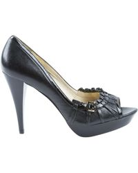 2ce332605ea Lyst - Michael Kors Patent Leather Round-toe Pumps in Black