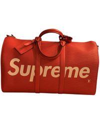 Lyst - Sac de voyage en cuir Louis Vuitton pour homme en coloris Rouge 37757a35d0a