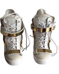 28f6c2d4342a Lyst - Giuseppe Zanotti Concealed Wedge Trainer in White