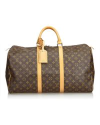 Louis Vuitton - Keepall Brown Plastic Travel Bag - Lyst