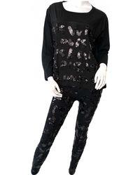 Louis Vuitton - Black Cotton Jumpsuits - Lyst