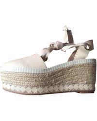 f6a3605cd306 Lyst - Tory Burch Solana Confetti Cork Platform Wedge Sandals in Brown