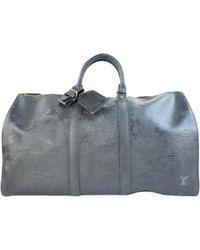 1ebb8e3e787cf Lyst - Louis Vuitton Pre-owned Keepall Leather 24h Bag in Black