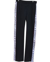 Givenchy - Pre-owned Trousers - Lyst