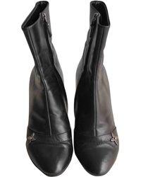 6103de1d5273 Lyst - Louis Vuitton Pre-owned Leather Biker Boots in Black