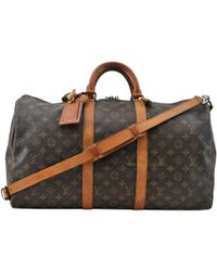 d0828a76eece Louis Vuitton - Vintage Keepall Brown Cloth Travel Bag - Lyst