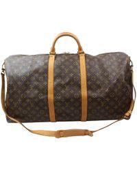 f40da6677674 Louis Vuitton - Pre-owned Vintage Keepall Brown Cloth Travel Bags - Lyst