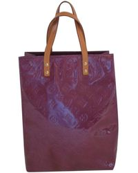 16837c1aa724 Lyst - Louis Vuitton Pre-owned Purple Patent Leather Handbags in Purple