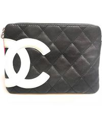 4da2dc752d04 Chanel Pre-owned Cambon Clutch Bag in Black - Lyst