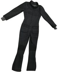 Chanel - Pre-owned Black Polyester Jumpsuits - Lyst