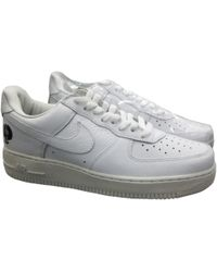 34da574a2f4 Nike Air Force 1 Leather Low Trainers in Orange for Men - Lyst