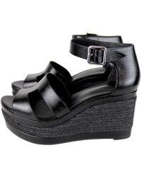 Hermès - Pre-owned Tilana Black Patent Leather Sandals - Lyst