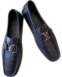 Louis Vuitton Mocassins cuir noir