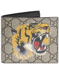 14465b2f32b Gucci GG Supreme Embroidered Tiger Billfold Wallet in Natural for ...