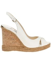 d6586e9001b Lyst - Jimmy Choo Treat Patent Leather Tstrap Wedge Sandals in Natural