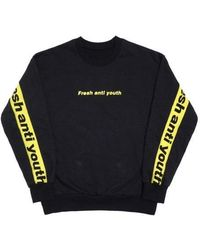 FRESH ANTI YOUTH - Band-crewneck Sweater Black Yellow - Lyst