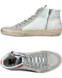 Golden Goose Deluxe Brand Sneakers abotinadas