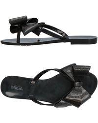 14d5fb945839 Lyst - Melissa Beach Bow Jelly Slide Sandal in Black