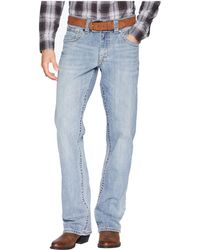Wrangler - Rock 47 Relaxed Boot Jeans (back Beat) Men's Jeans - Lyst
