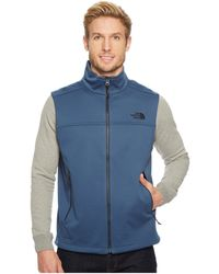 lyst the north face canyonwall vest in blue for men rh lyst com