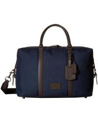 COACH - Explorer Bag (qb/bright Navy/chestnut) Bags - Lyst