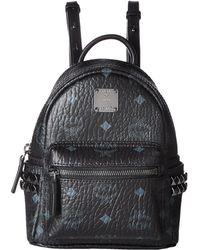 7d4f20ba2e44 Lyst - MCM Stark Side-stud Small Medium Backpack (black) Backpack ...