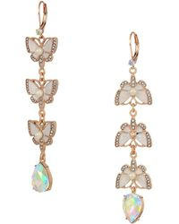 Betsey Johnson - Rose Gold And White Butterfly Linear Non-matching Earrings - Lyst