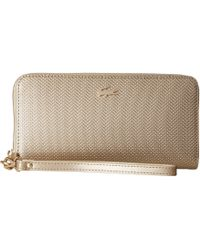 Lacoste | Chantaco Holidays Large Wristlet Zip Wallet | Lyst