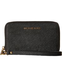 MICHAEL Michael Kors - Jet Set Travel Large Flat Mf Phone Case - Lyst
