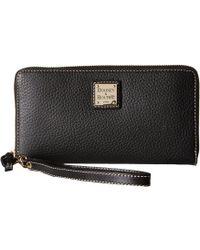 Dooney & Bourke - Pebble Leather Large Zip Around Wristlet (caramel) Wristlet Handbags - Lyst