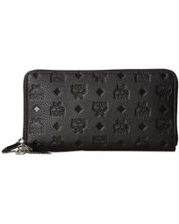 MCM - Klara Monogrammed Leather Charm Zipped Wallet Large (black) Wallet Handbags - Lyst