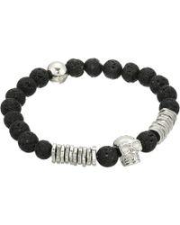 Steve Madden - Lava Bead Skull Design Stretch Bracelet In Stainless Steel (black/silver) Bracelet - Lyst