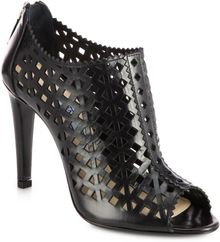 Prada Leather Cutout Ankle Boots - Lyst