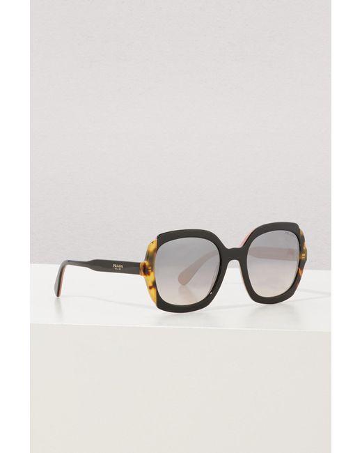 858e617fe0f16d Lyst - Lunettes de soleil Etiquette Prada en coloris Marron