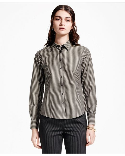 The best dress shirts fit comfortably around the chest, under the armpits, and across the upper back, giving you a full range of motion. A fitted shirt will feel snug, but not too tight. Your chest should