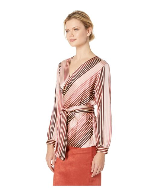 8bcb7692d8e ... Vince Camuto - Pink Long Sleeve Stripe Soiree Belted Wrap Blouse - Lyst  ...