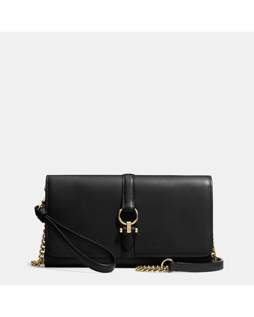 Coach Nomad Crossbody Clutch In Glovetanned Leather In