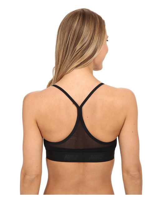 Juniors IZOD Racerback Sports Bra IZ Blue. Juniors IZOD PERFORMx solid racerback sports bra is the ideal style for an active lady. The one piece features a comfort elastic wing band with a logo design, adjustable straps, and a hook & eye back closure. 90% Polyester. 10% Spandex.