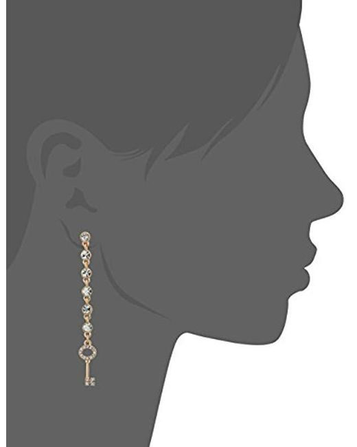 Guess - Metallic Mismatched Ears Post Drop Crystal Stone Earrings, Gold, One Size - Lyst