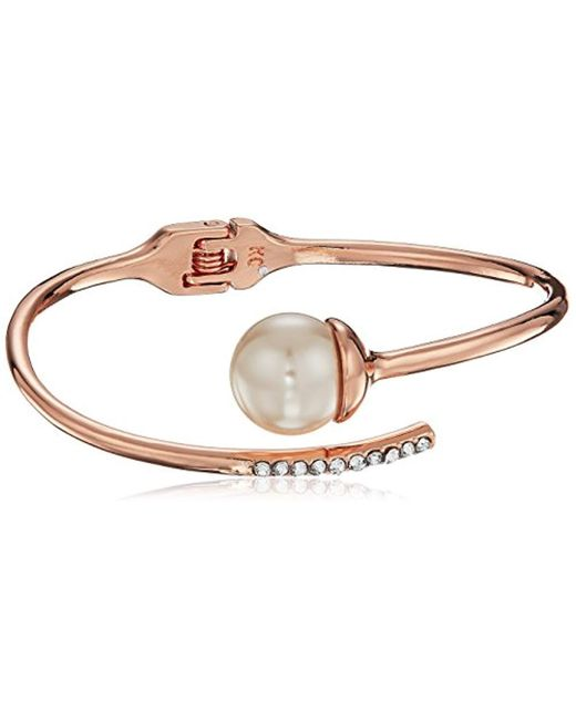 Kenneth Cole - Metallic S Rose Gold Pearl Bypass Bangle, Blush, One Size - Lyst