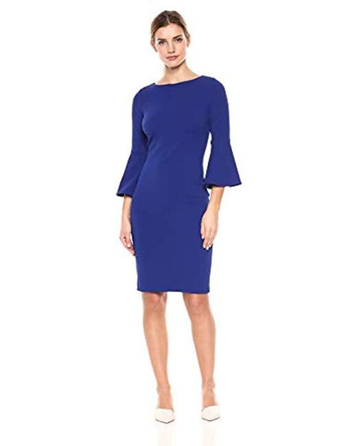 37599d0102 Lyst - Calvin Klein 3 4 Peplum Sleeve Sheath Dress in Blue