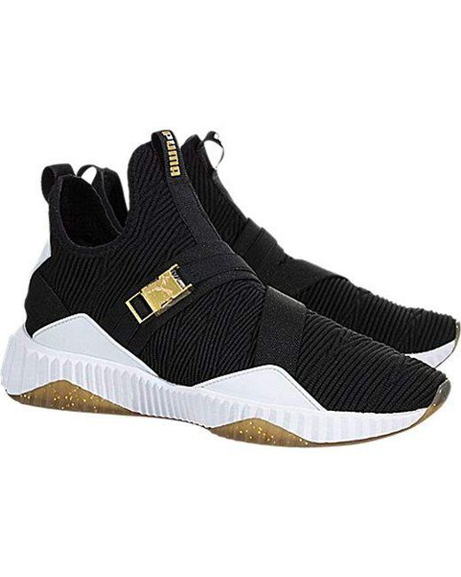 7c65409f2f5d08 ... Lyst PUMA - Black Women s Defy Varsity Knit Mid Top Sneakers ...