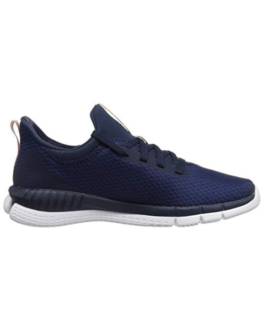 395742e98f61e2 Lyst - Reebok Print Her 2.0 Thrd Running Shoe in Blue - Save 19%